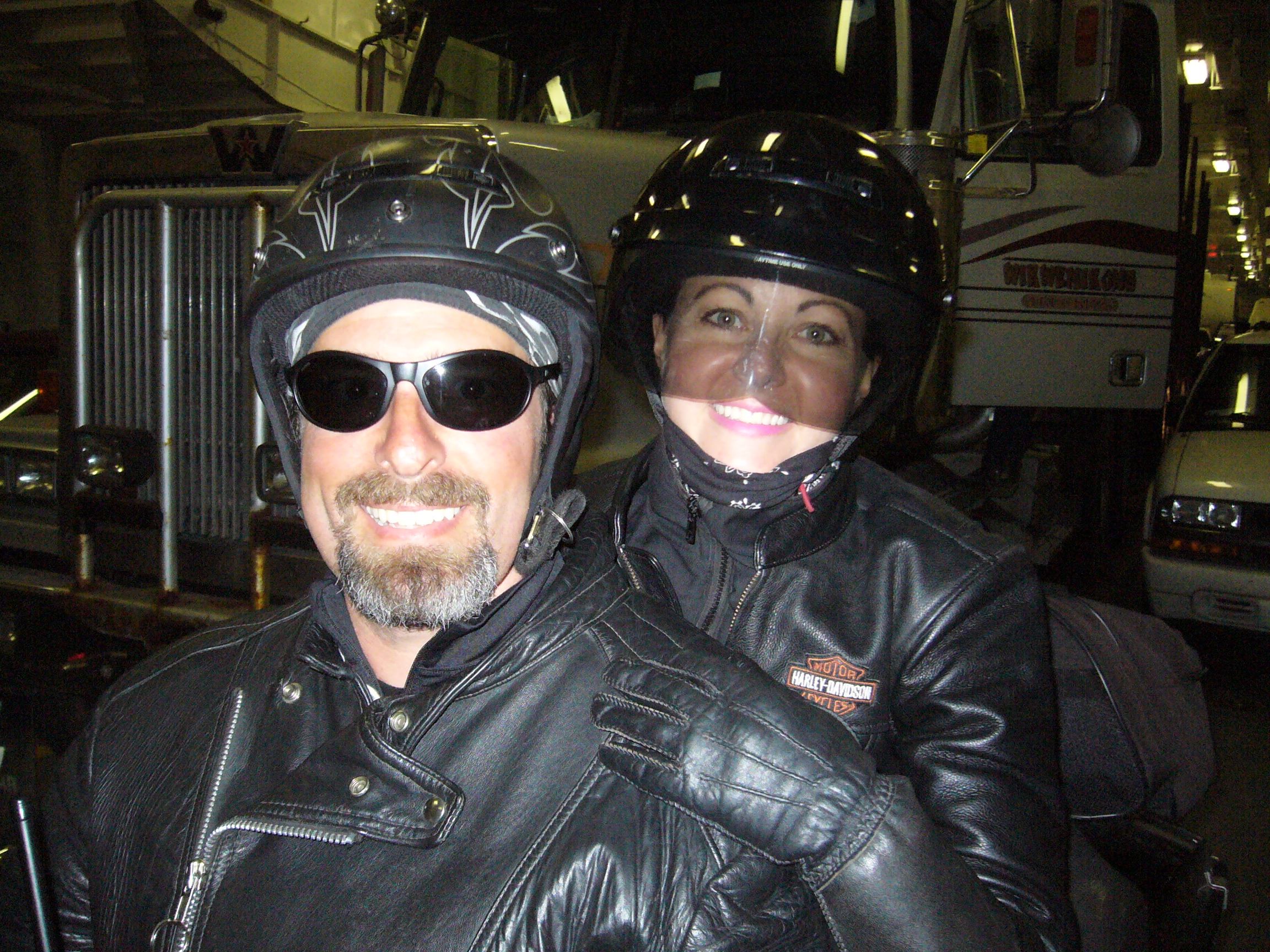 couple on a motorcycle smiling