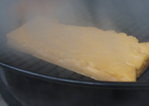 cheese smoking on grill