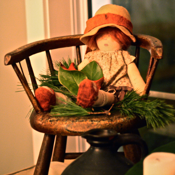 antique childs chair with doll and magnolia