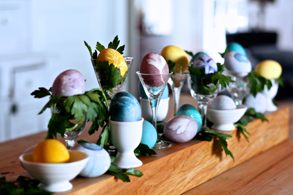 easter sggs displayed in vintage egg cups and sherry glasses