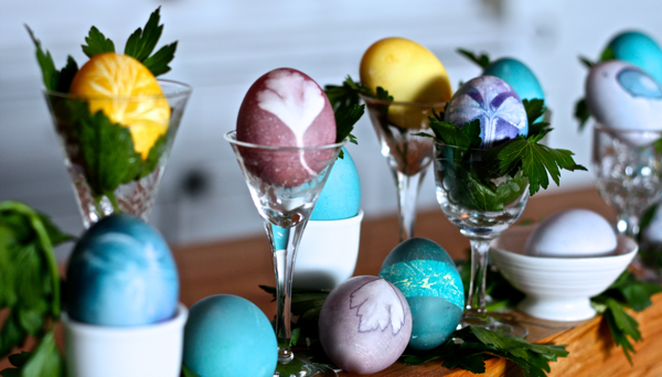 eggs displayed for easter in vintage glasses