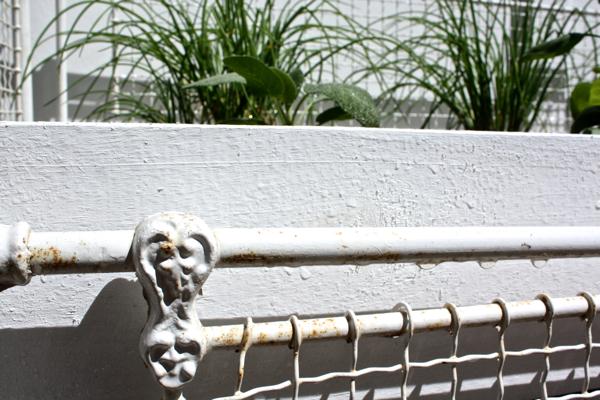 detail of antique crib turned herb garden cynthiaweber.com