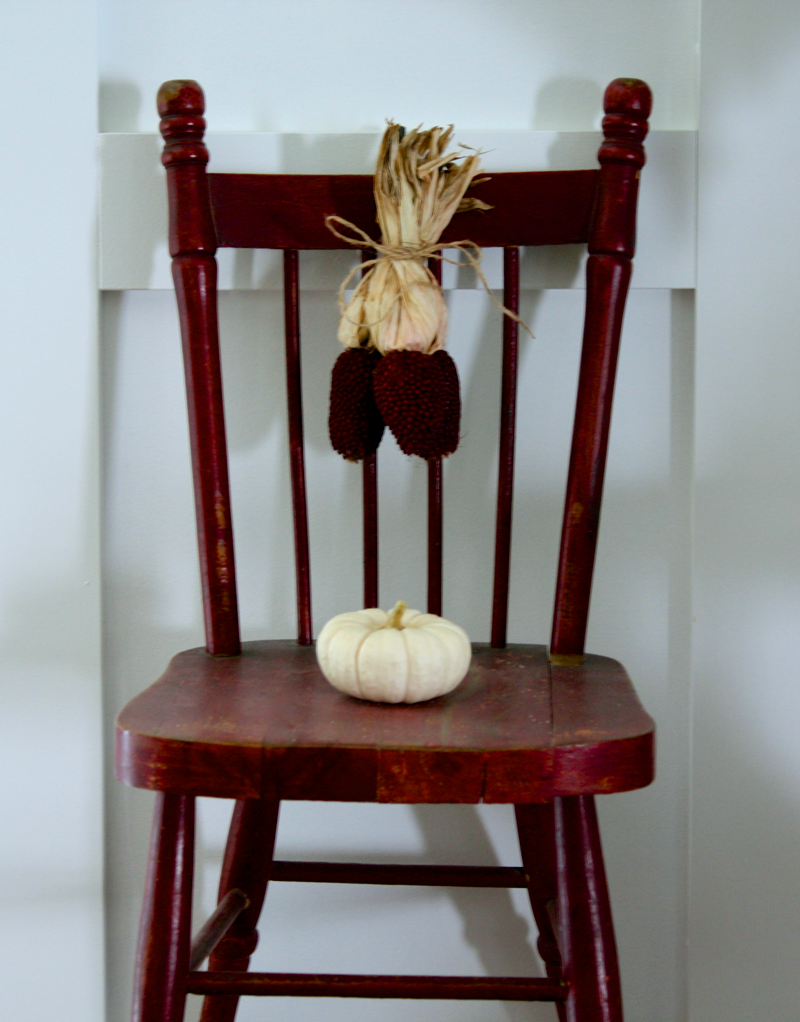 Little chair hanging on the wall… cynthiaweber.com