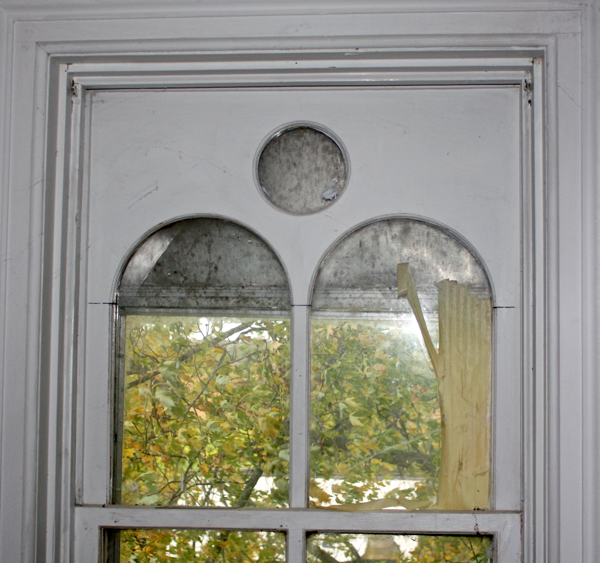 Antique window to salvage before house is demolished