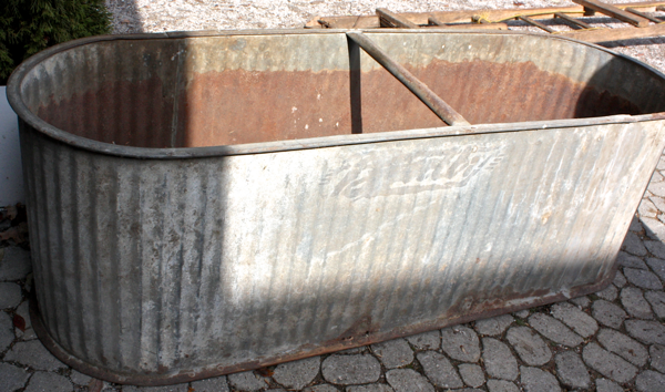 Salvaged water trough will make fantastic outdoor planter...