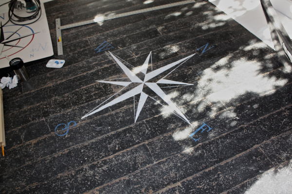 Compass painting on entrance floor for Cleint Diaries- Jess & Brad cottage reno blog series