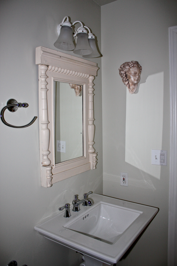 Mirror made with salvaged trim pieces