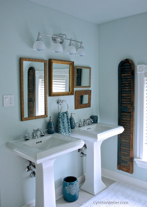 Mixed metals, gilt mirrors and salvaged shutters combine in this vintage glam bathroom reno project CynthiaWeber.com