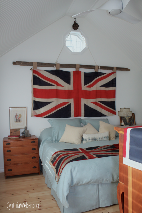 Rustic Bedroom Ideas… Union Jack Flag hung by an antique pulley on a cedar rail… CynthiaWeber.com