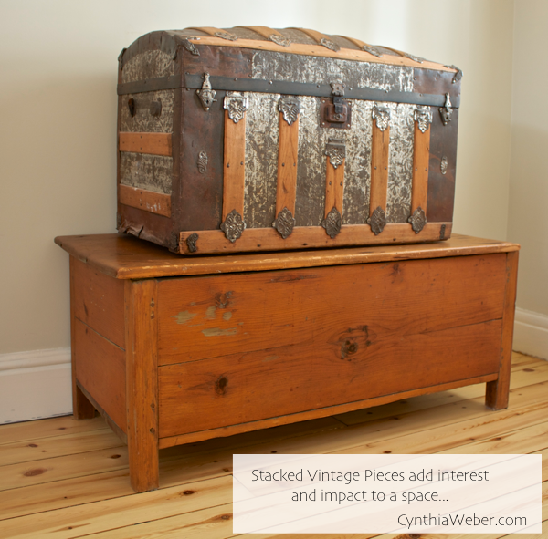 Stacked Vintage pieces add interest and impact to a space… CynthiaWeber.com