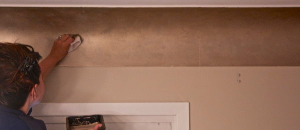 Applying layers of matte metallic paint to plaster coving … CynthiaWeber.com