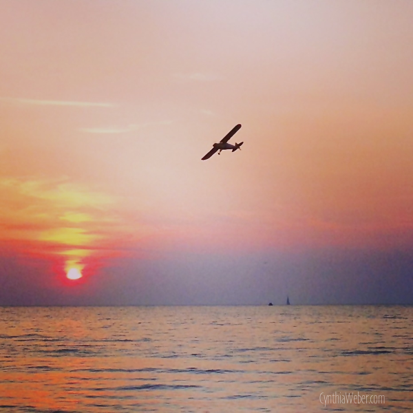 Plane over Sunset on Bayfield Beach… CynthiaWeber.com