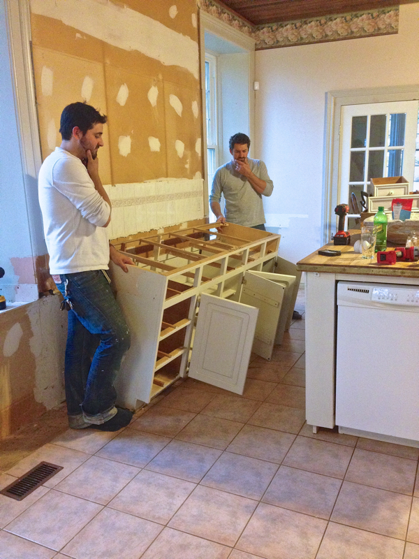 Playing pensive for effect… Taking out cabinets at BannockBurn… CynthiaWeber.com