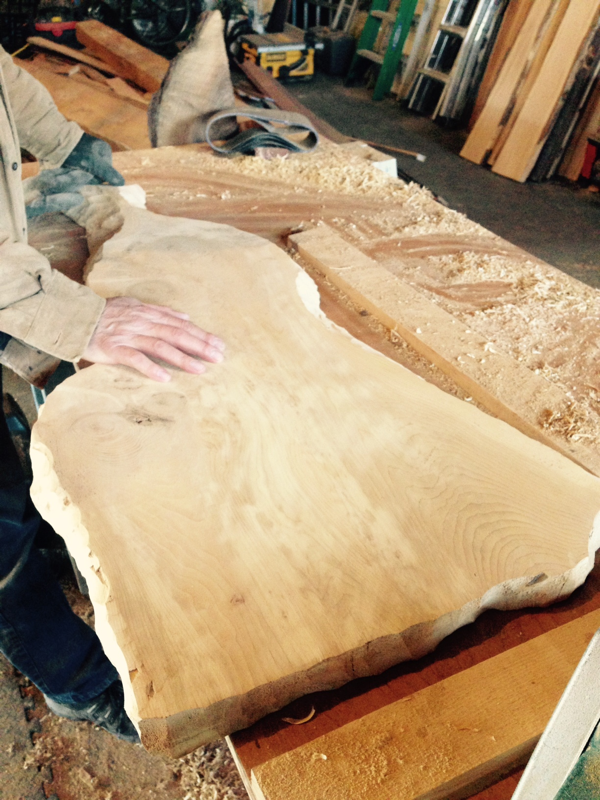 Kent working on a live edge serving board in the barn … Cynthiaweber.com
