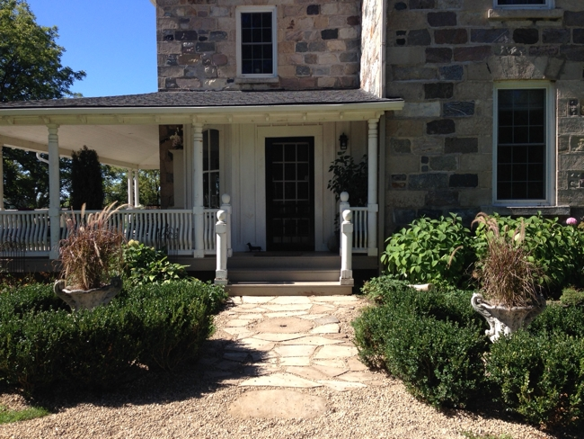 The side door pathway featuring a gristmill stone found buried on the property… Cynthiaweber.com