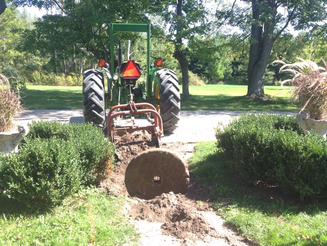 finding the gristmill stone buried under the flagstone pathway… cynthiaweber.com