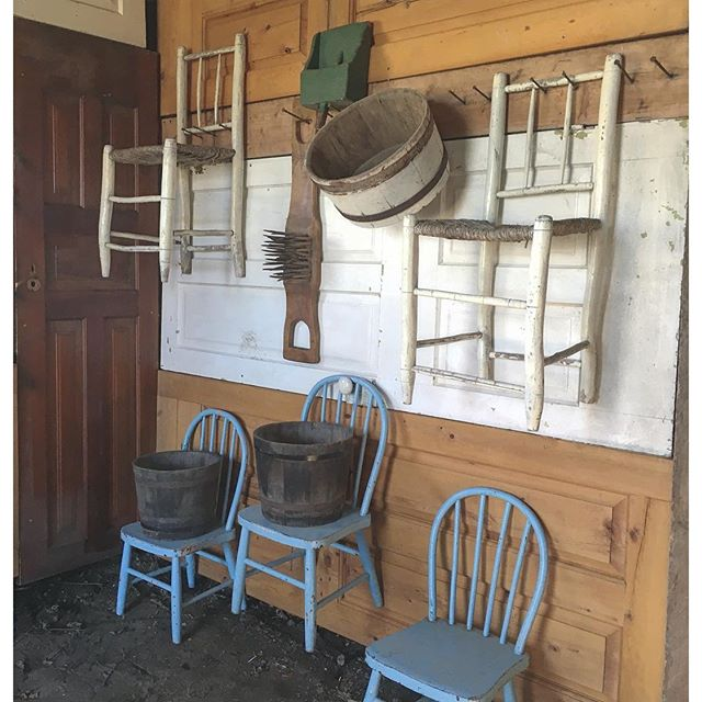 old doors and antique children sized chairs hung in the horse barn at BannockBurn 1878...